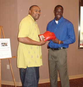 Clarence Weatherspoon (left) with Deontay Wilder (right)