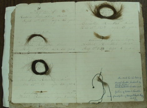 Lockets of hair from deceased members of the Randle family in the 1880s and placed inside the family Bible.