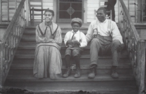 Geneva and Mitch Shackelford with unidentified boy, c. 1910s.